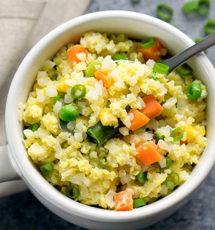 Cauliflower and vegetable fried rice in a mug.