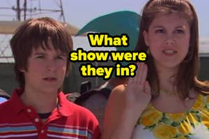 Ned stands next to Moze as she raises on hand in the air.