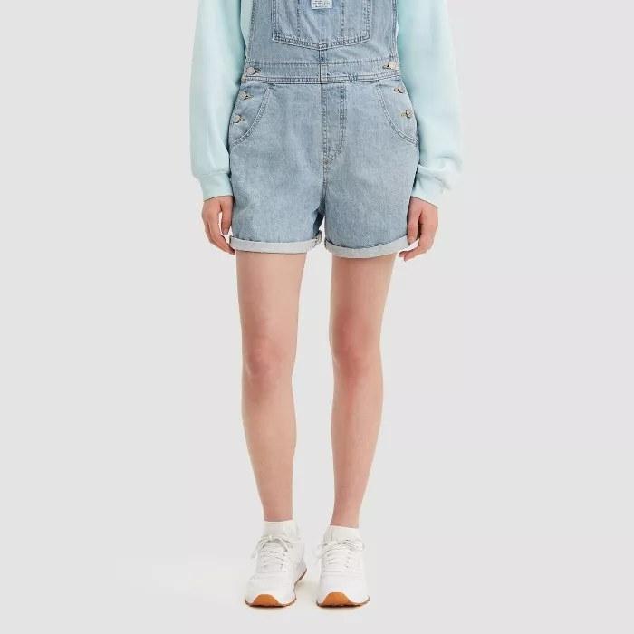 A model wearing the shortalls
