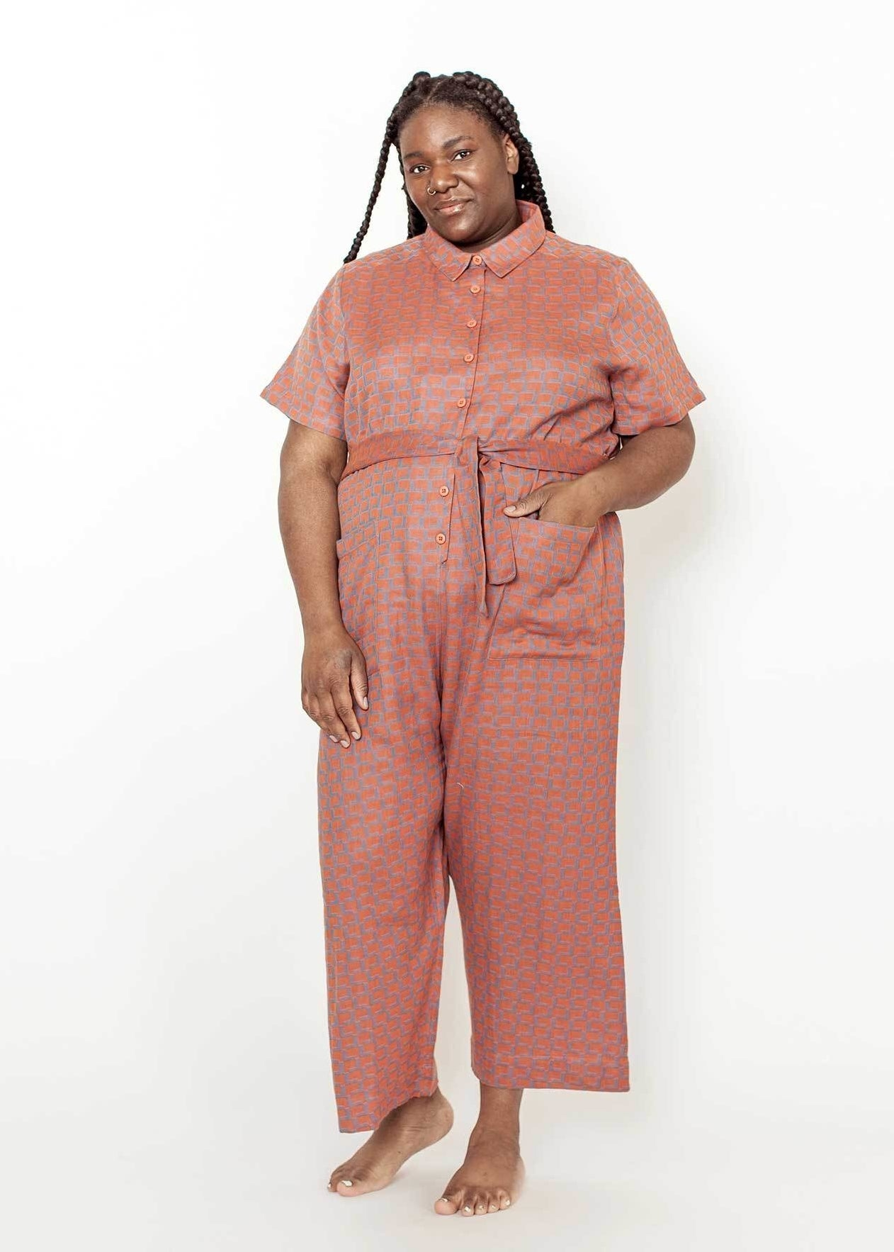 a plus size model wearing the ernie jumpsuit in makeup