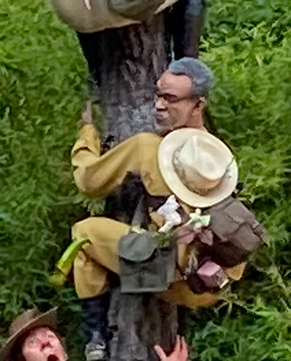 A man with bags of plants on his back