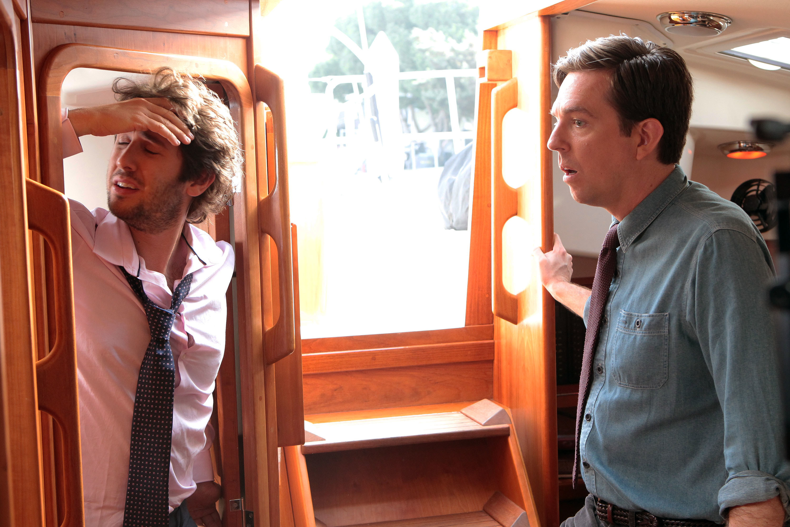 Josh Groban and Ed Helms on a boat