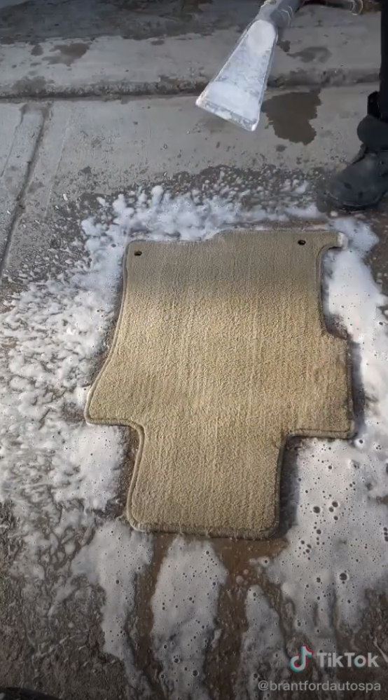 The same door mat now cleaned to its normal beige color