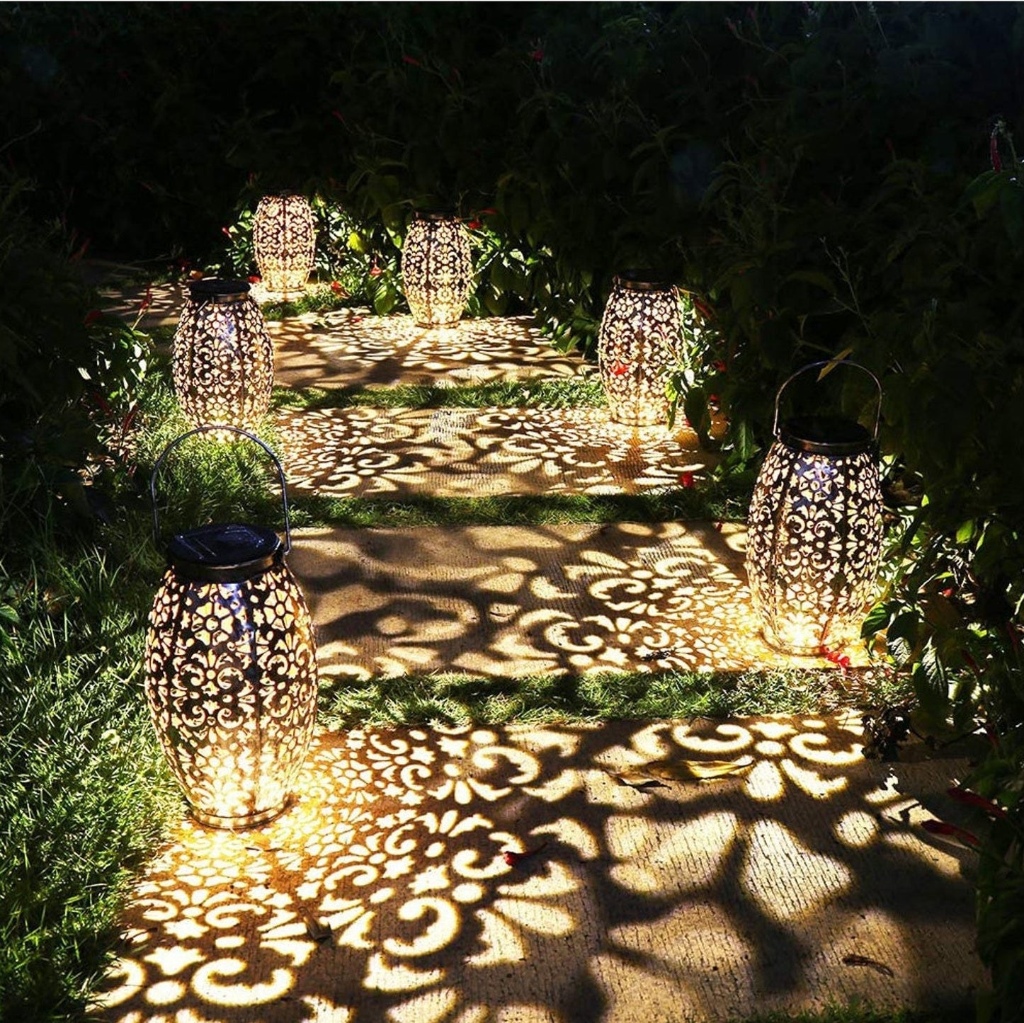 Six lanterns lighting up a pathway with stunning cut out designs