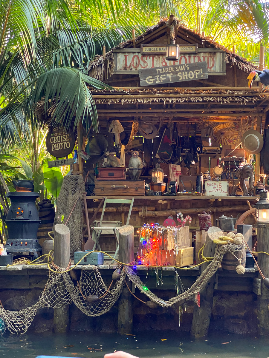 Trader Sam's shop, which is made of wood and has a thatch roof and many lost and found items