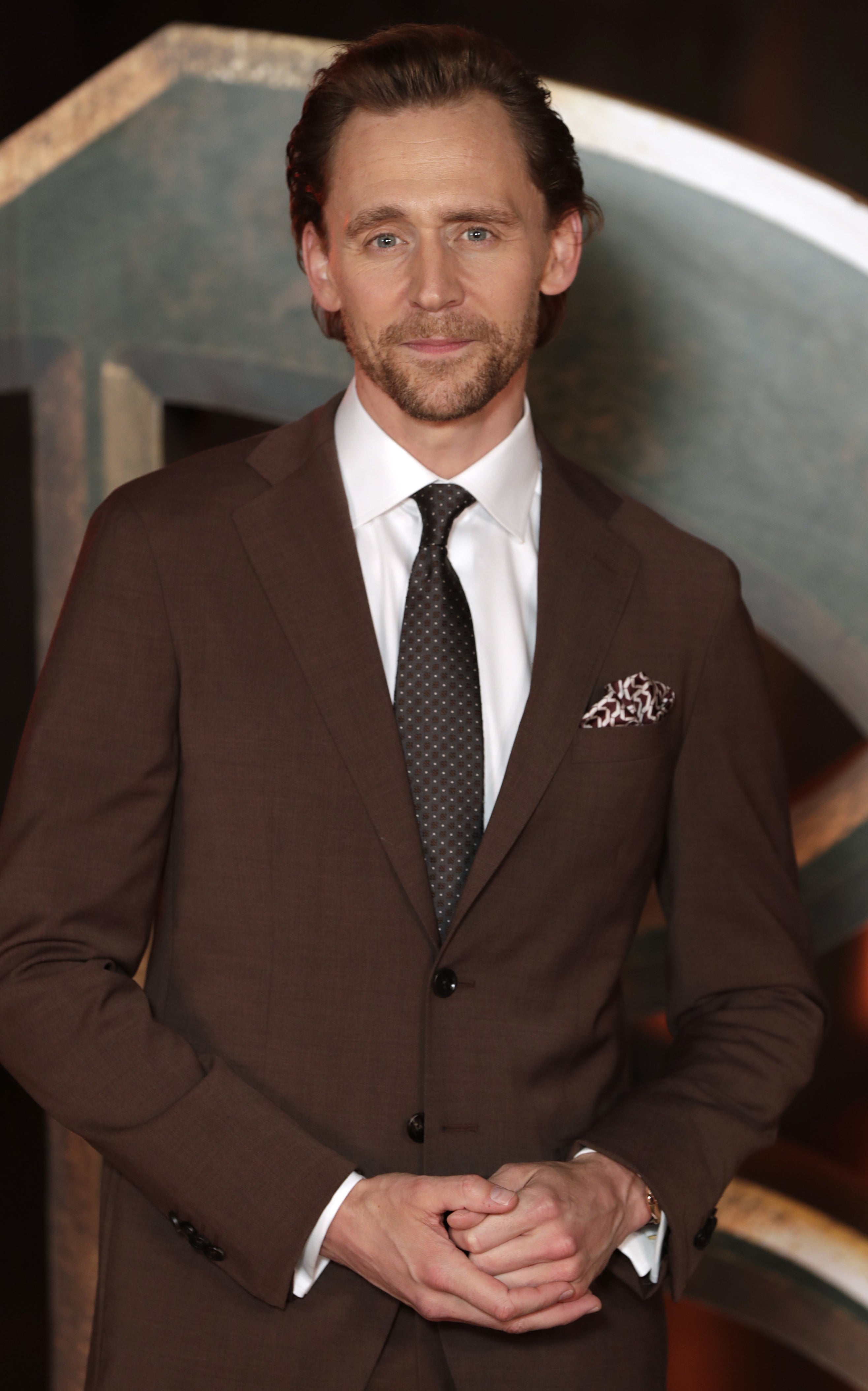 Tom wearing a suit at a red carpet event