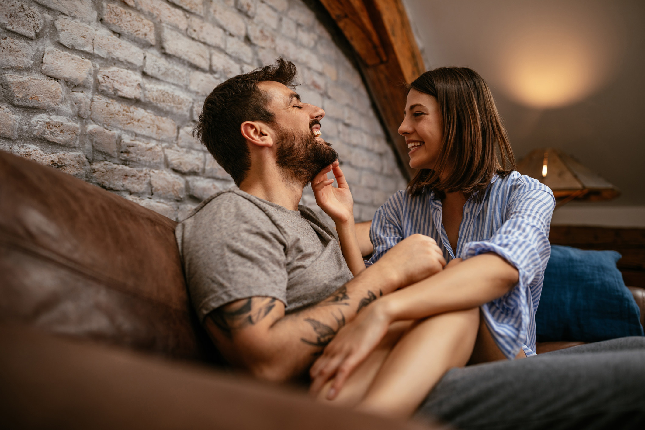 Shot of a happy young couple cuddling in the living room