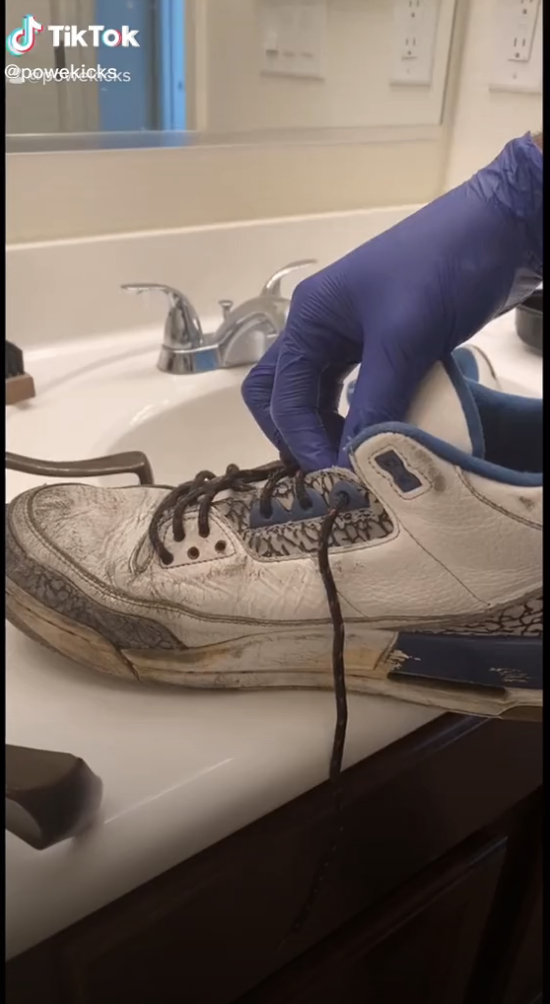 An old sneaker that's dirty and worn out