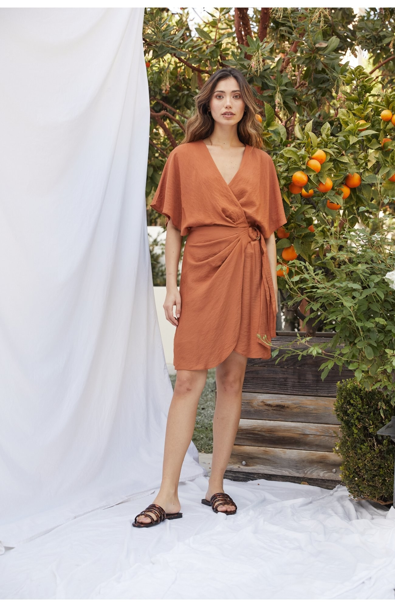 model wearing the brown rusty colored dress