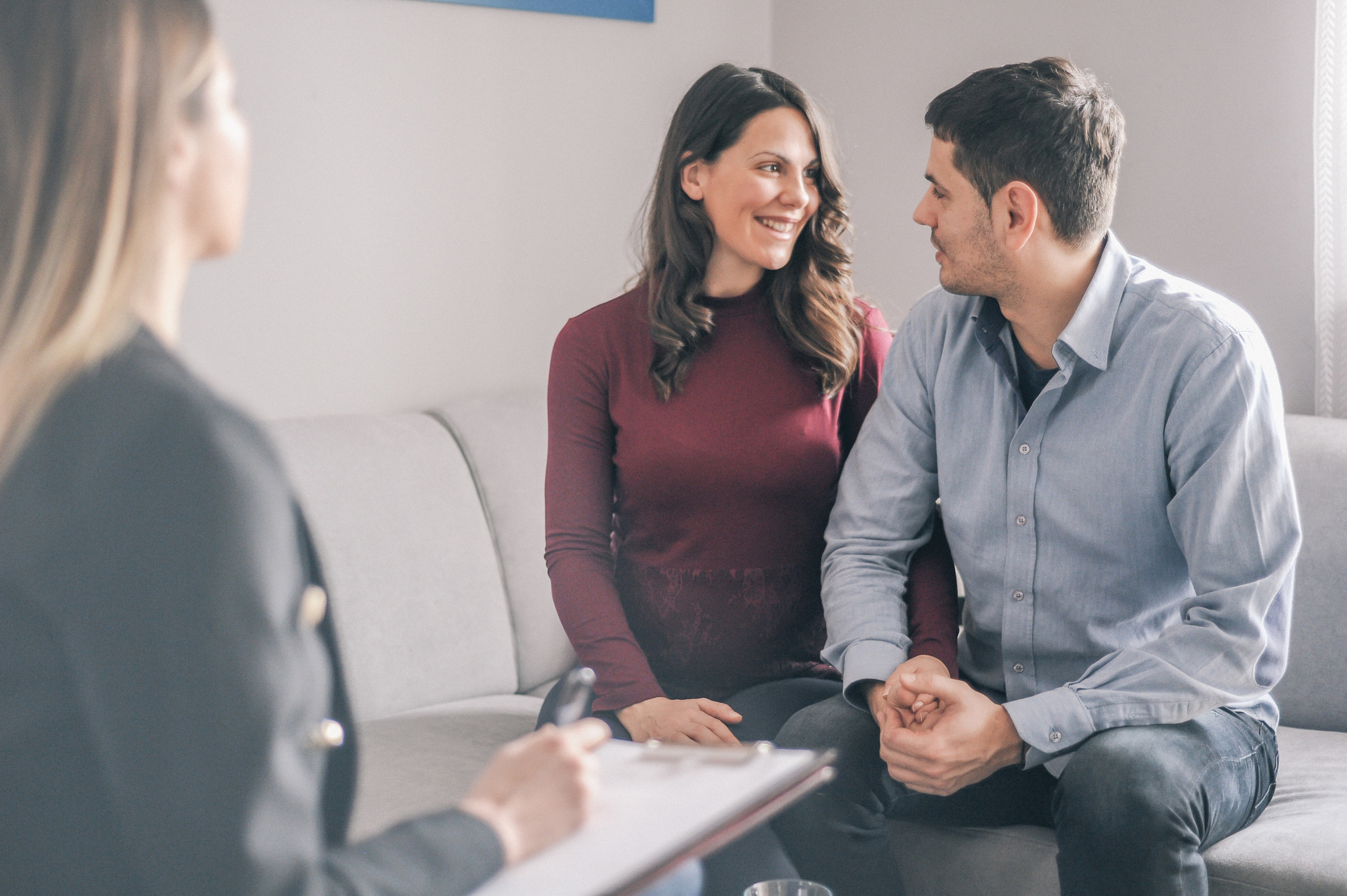 A happy couple in counseling appointment