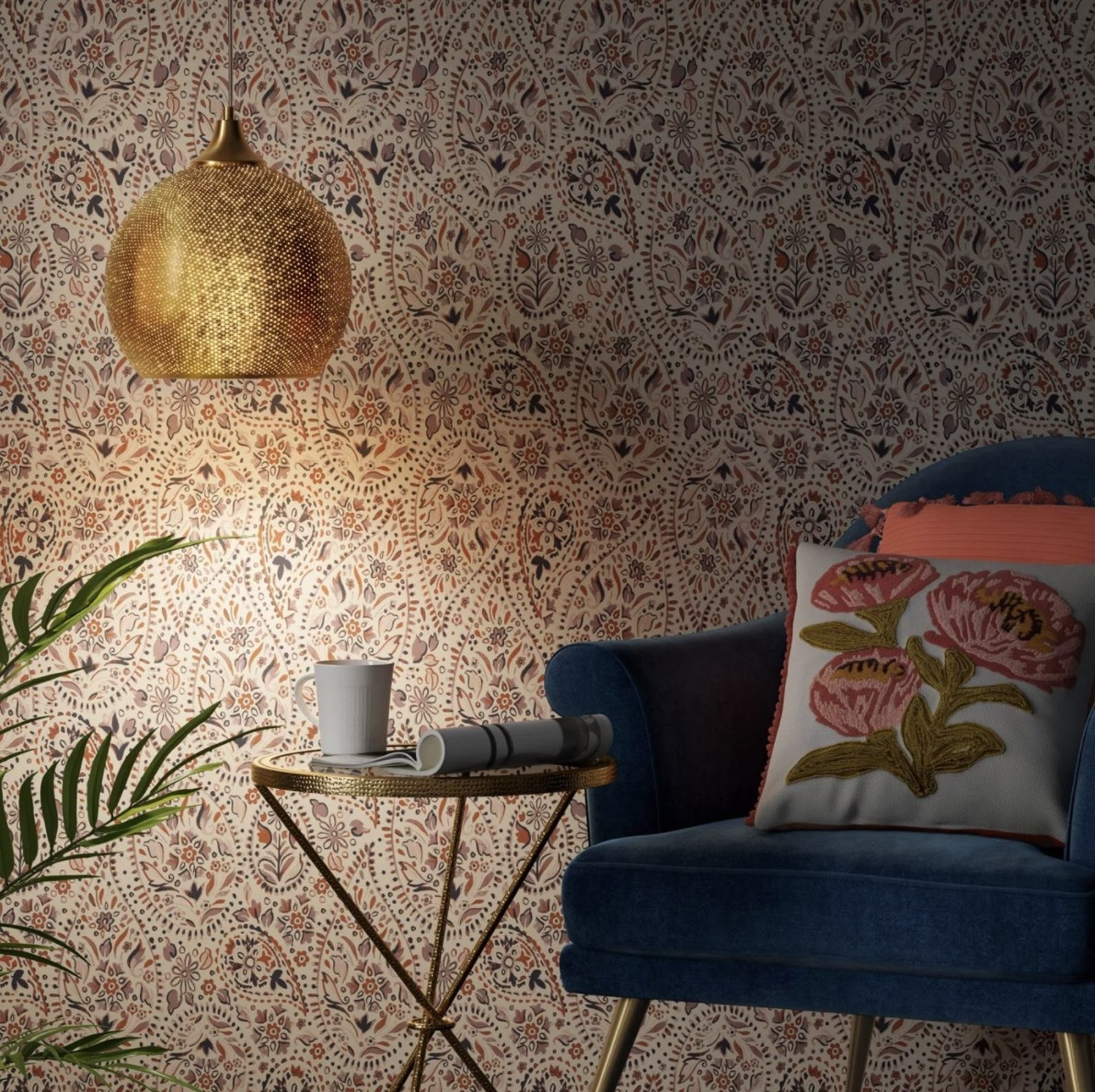 The gold hanging lamp is in a dimly lit room and gives off a beautiful ambient light