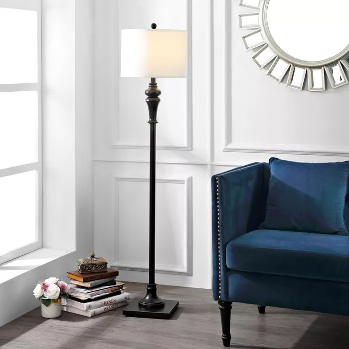 The black floor lamp with a white shade