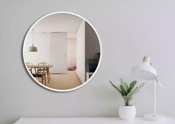 The white circular mirror