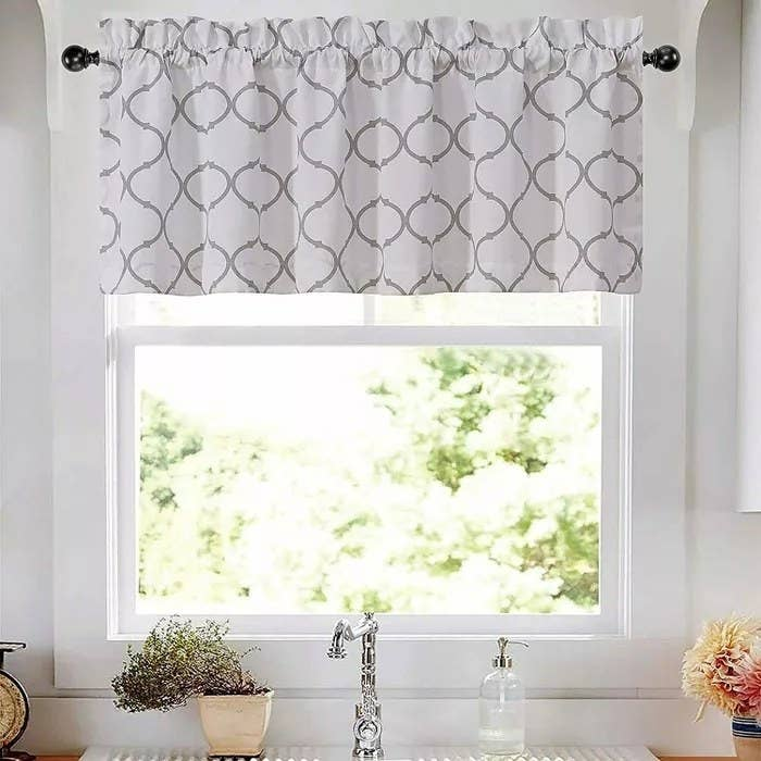 A white and gray window valance