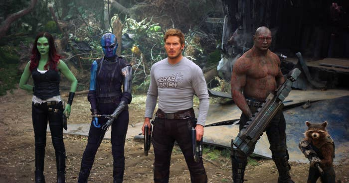 The cast of Guardians poses outside looking ready for battle in a scene from the movie