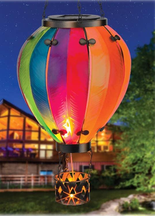A hot air balloon garden sculpture lit up