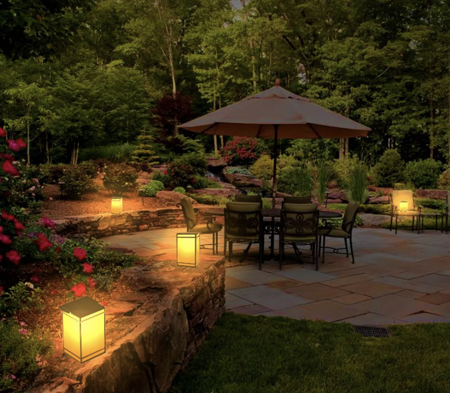 Portable rectangular lanterns with handles scattered around a patio