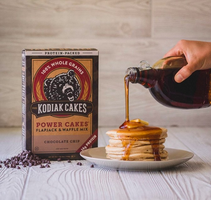 The power cakes mix next to a stack of pancakes