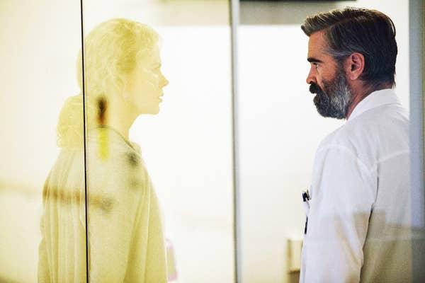 Colin Farrell looking at Nicole Kidman through glass