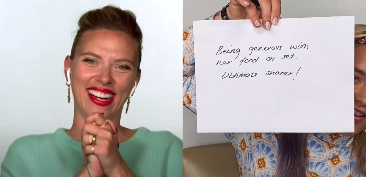 Scarlett laughs while Florence holds up a sheet of paper with something written on it.
