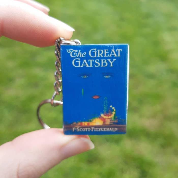 person holding up great gatsby keychain