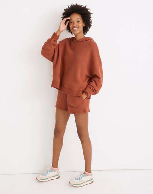 model in the brick color sweatshirt