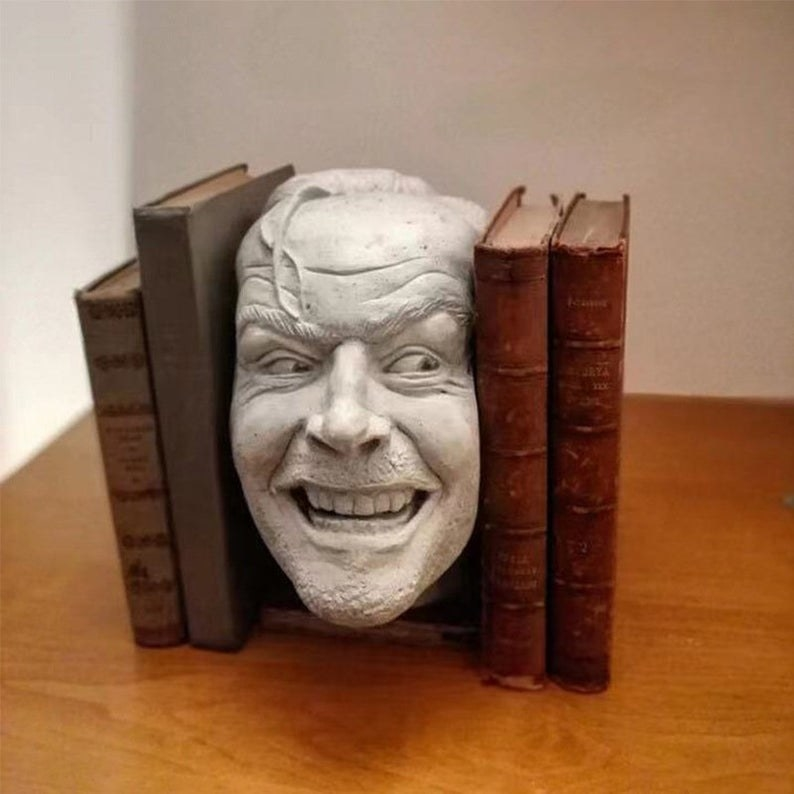jack nicholson model bookend in between two sets of books
