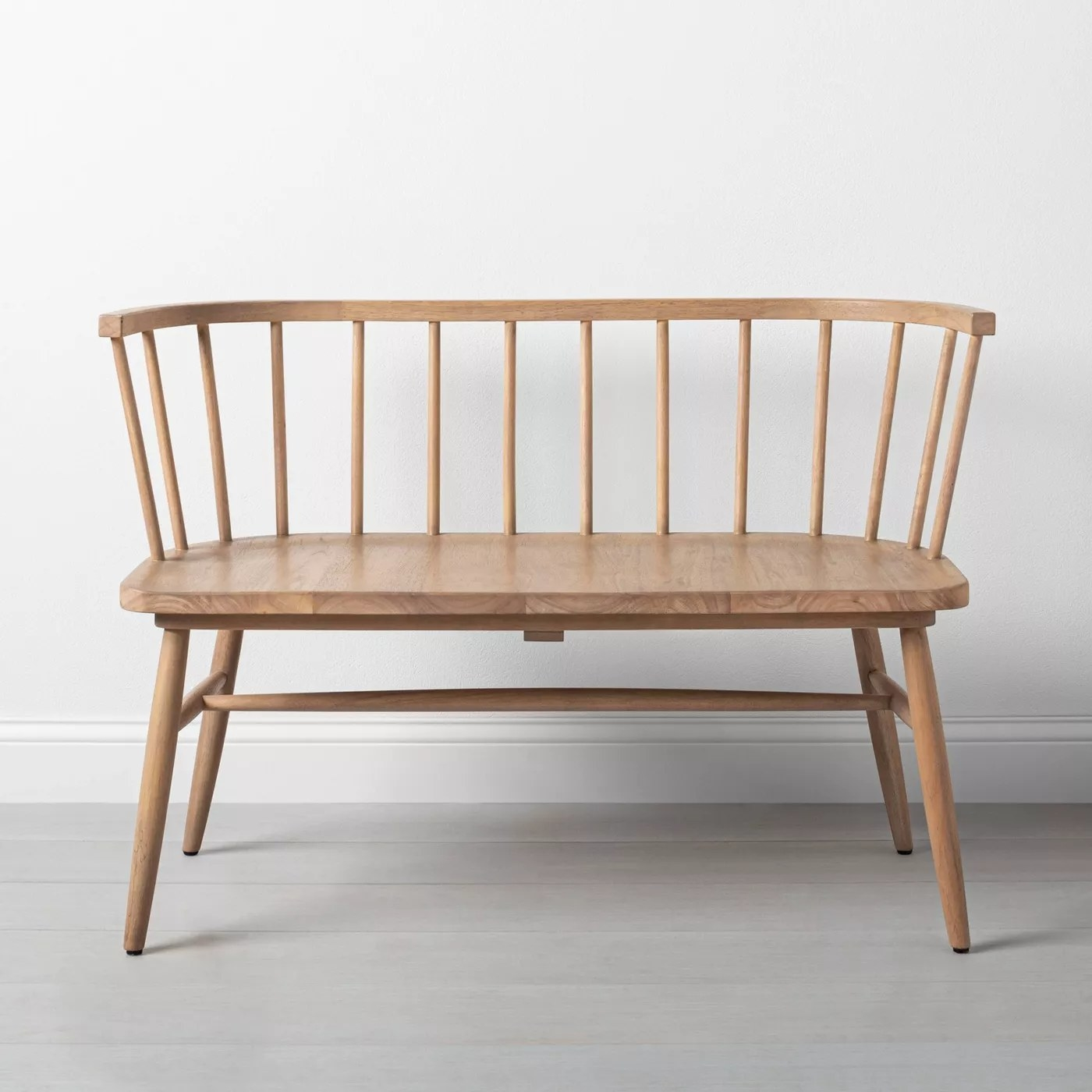 The long, curved bench with a partially see-through back