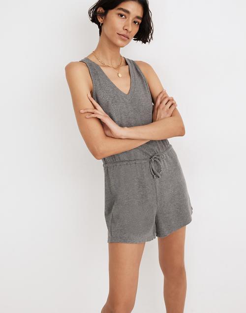 A model wears the romper in gray