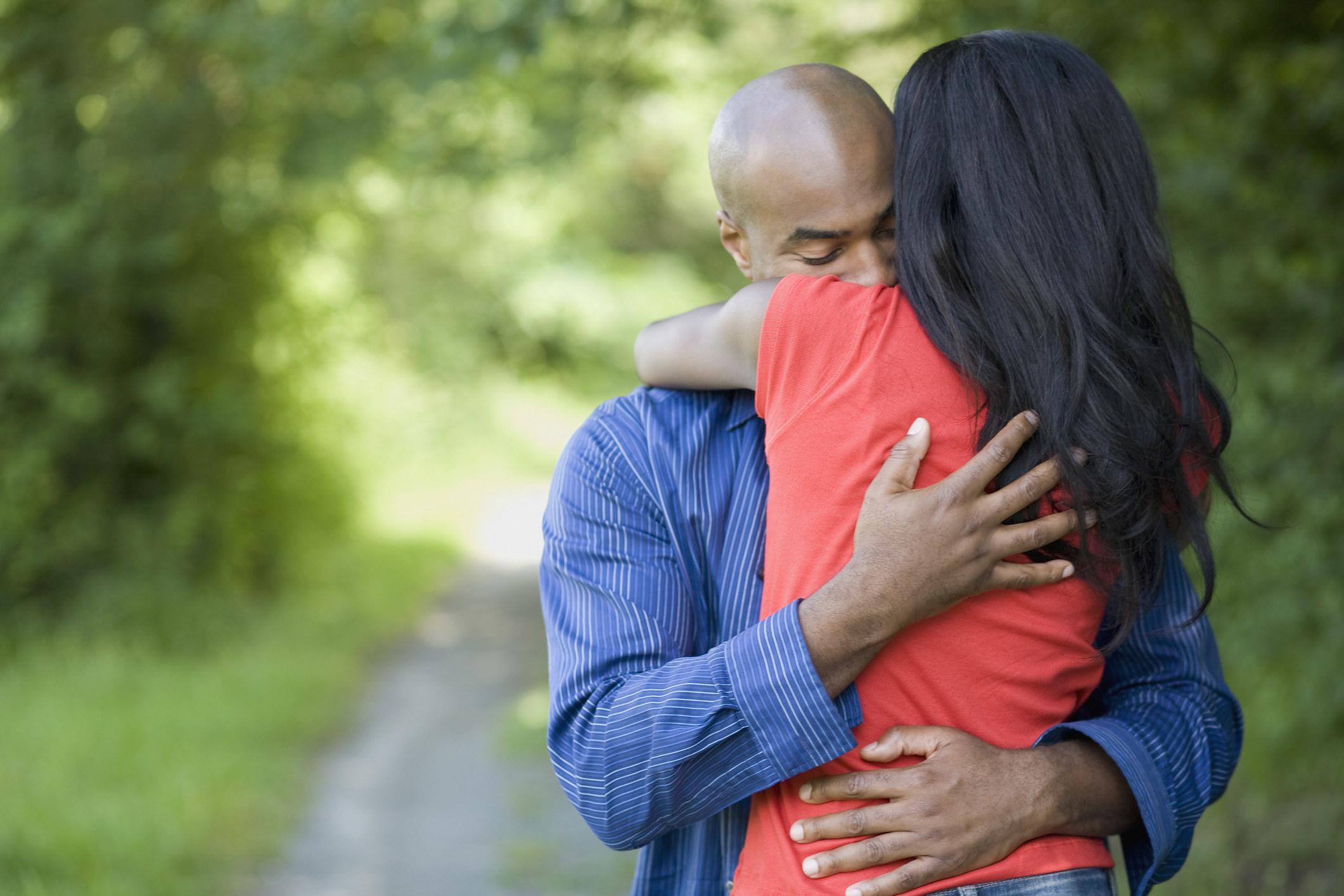 a girlfriend consoling her boyfriend