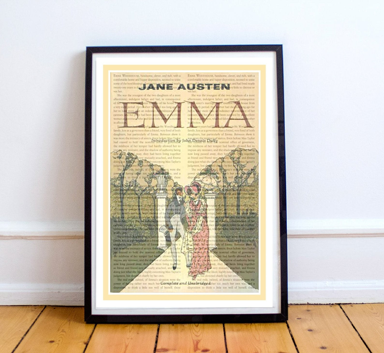 the art print with text framed with a black frame and sitting on the floor