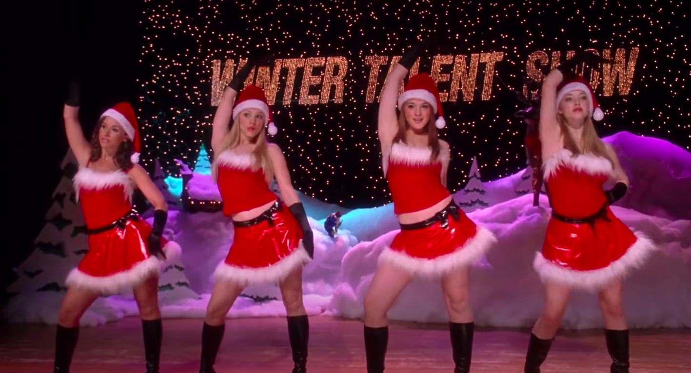 Gretchen, Regina, Cady, and Karen wearing miniskirts and tank-tops