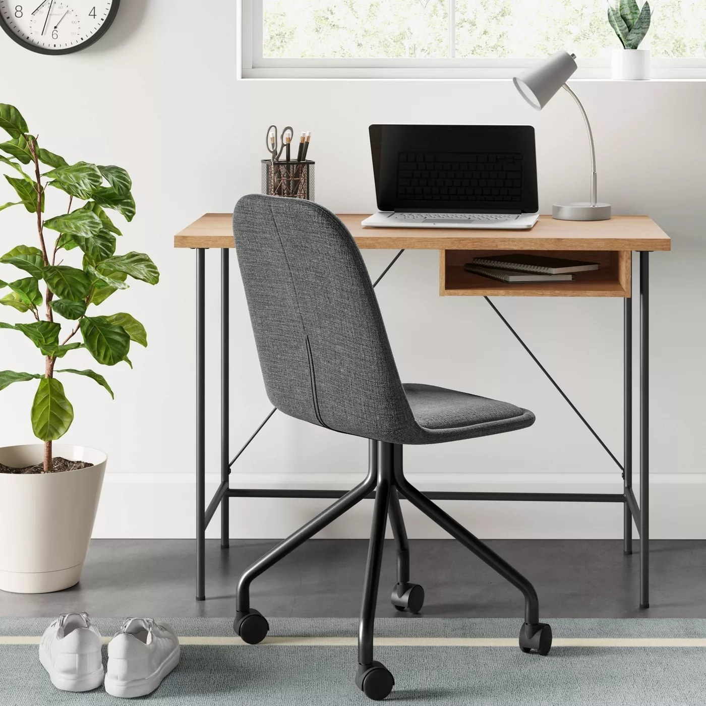 The wood and metal desk with a hidden shelf in an office