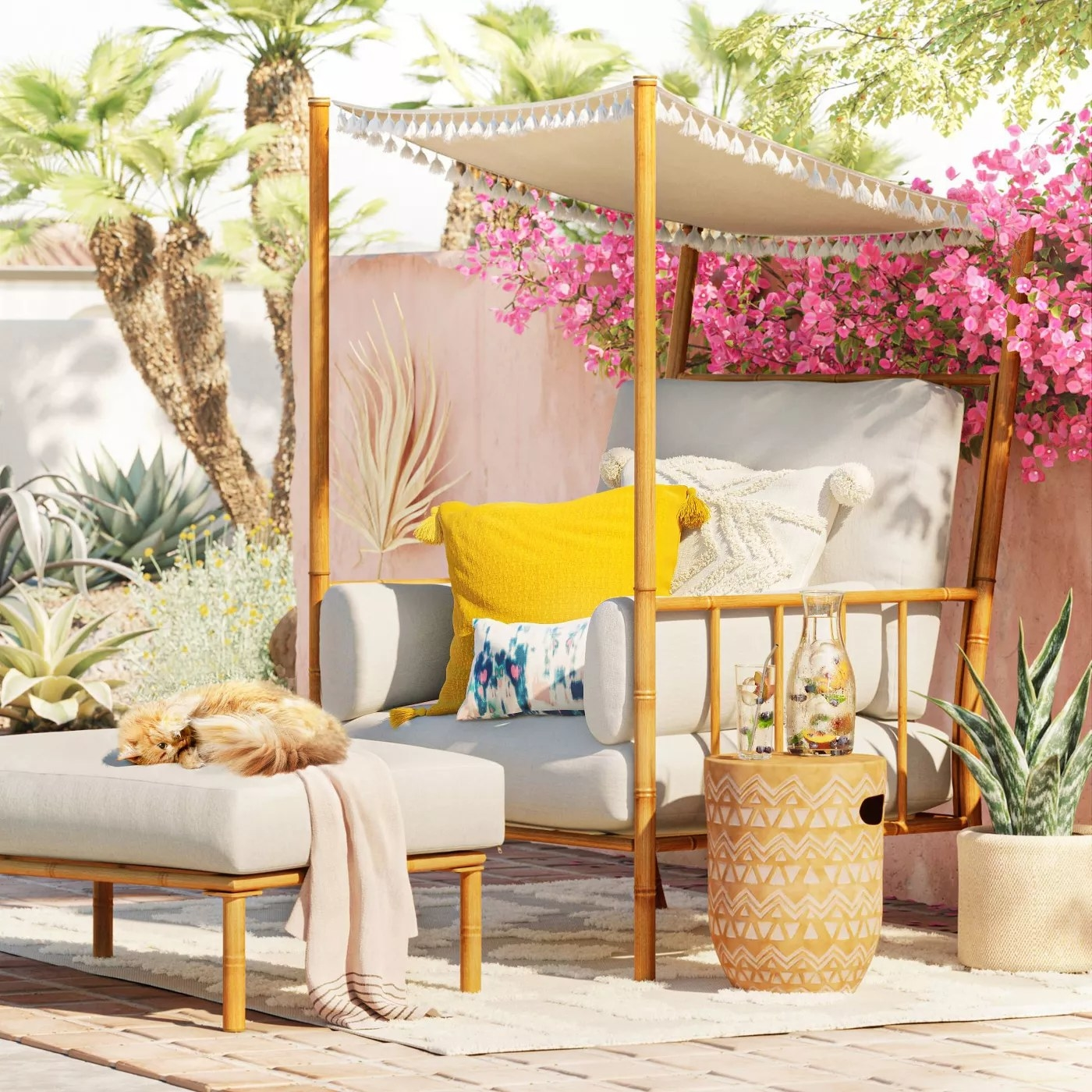 The chair with a canopy and plush cushions in a backyard