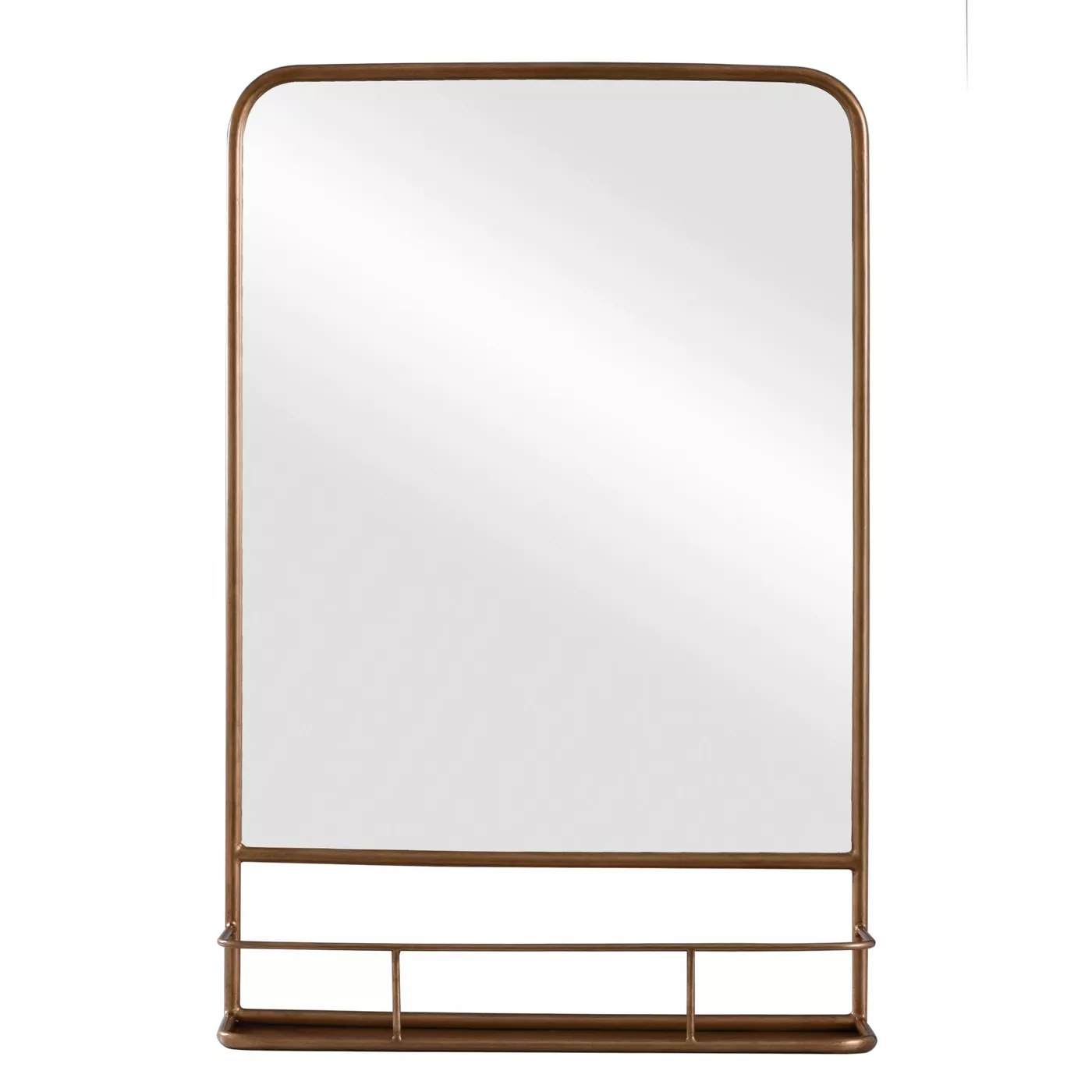 The rectangular mirror with brass trim and a built-in shelf underneath