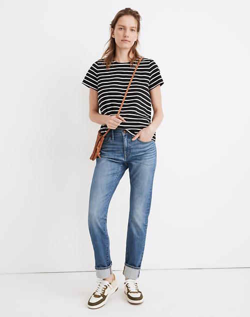 A model wears the jeans cuffed