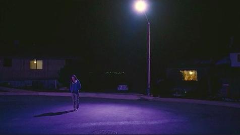 "Olivia Rodrigo walking alone at night in her ""Driver's License"" music video"