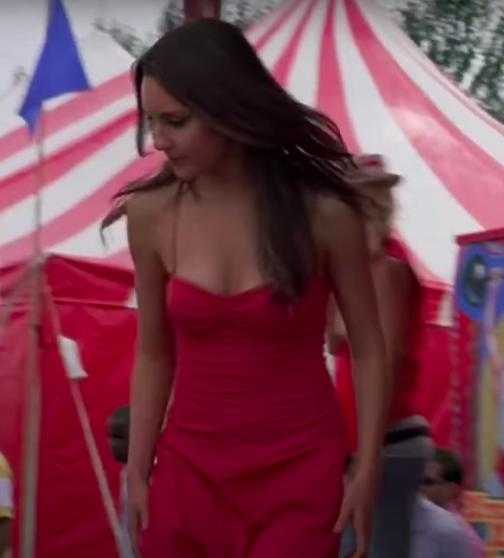 Viola wearing a midi dress with small straps