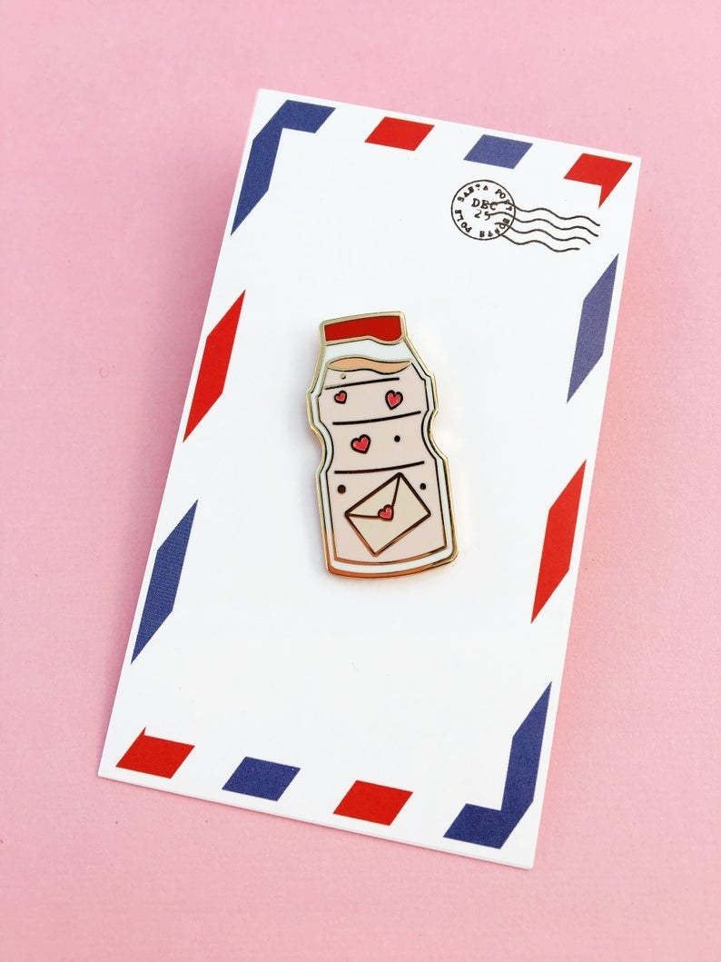 yakult pin on a letter-inspired background