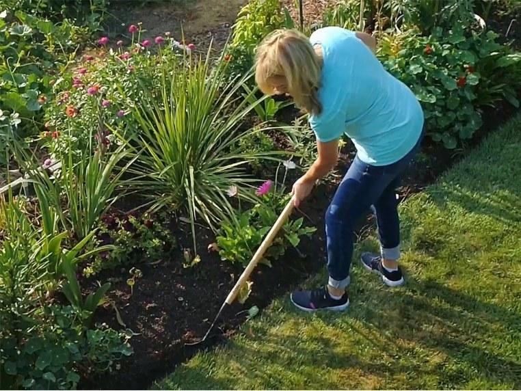 person using garden edger