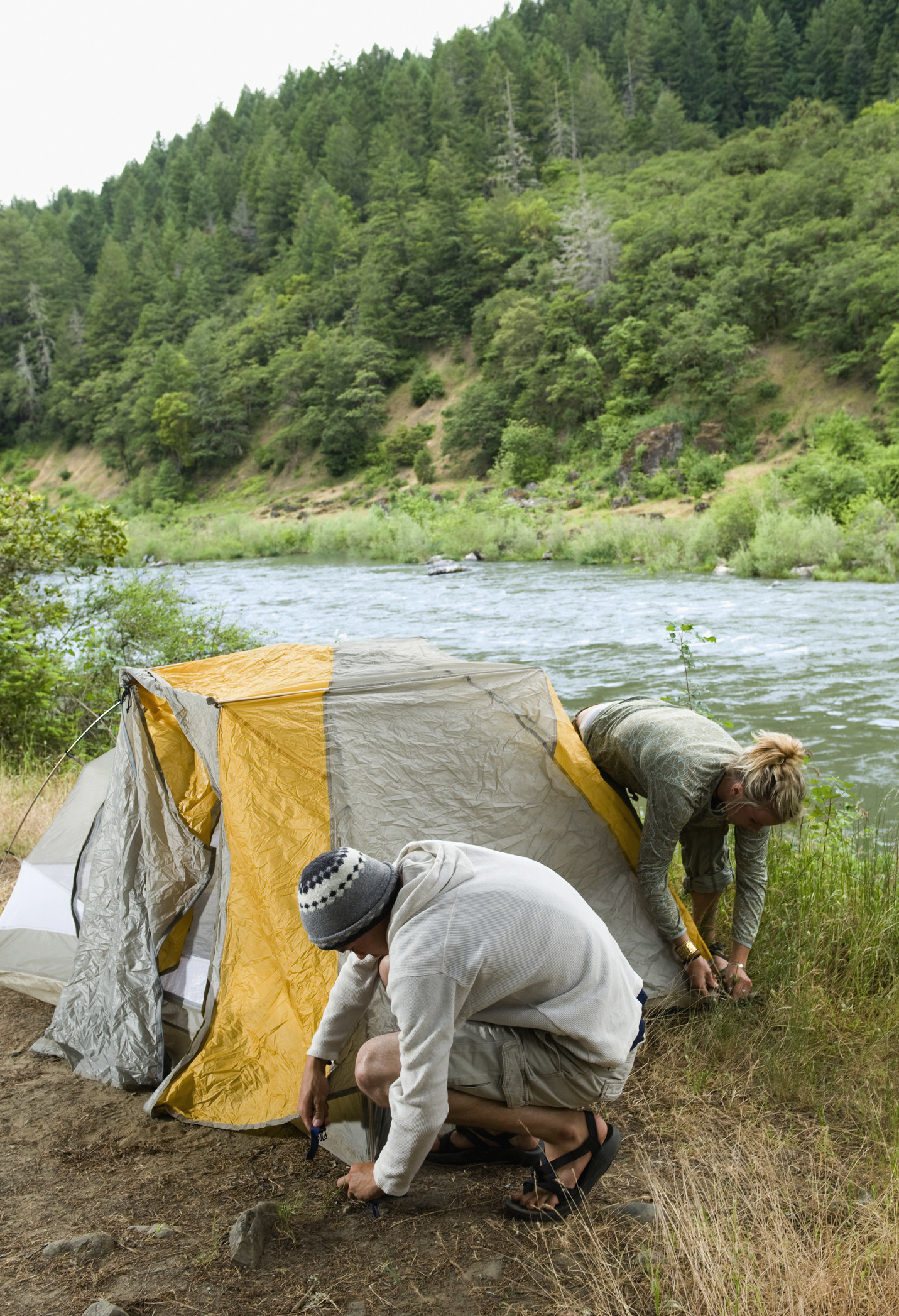 A couple setting up their tent.