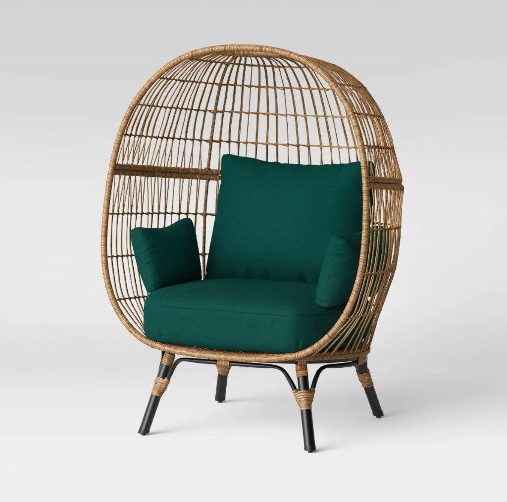 the wicker chair with green cushions