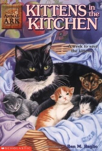 A mother kitten (black) cuddles her little of kittens