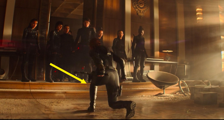Natasha kneeling before a fight