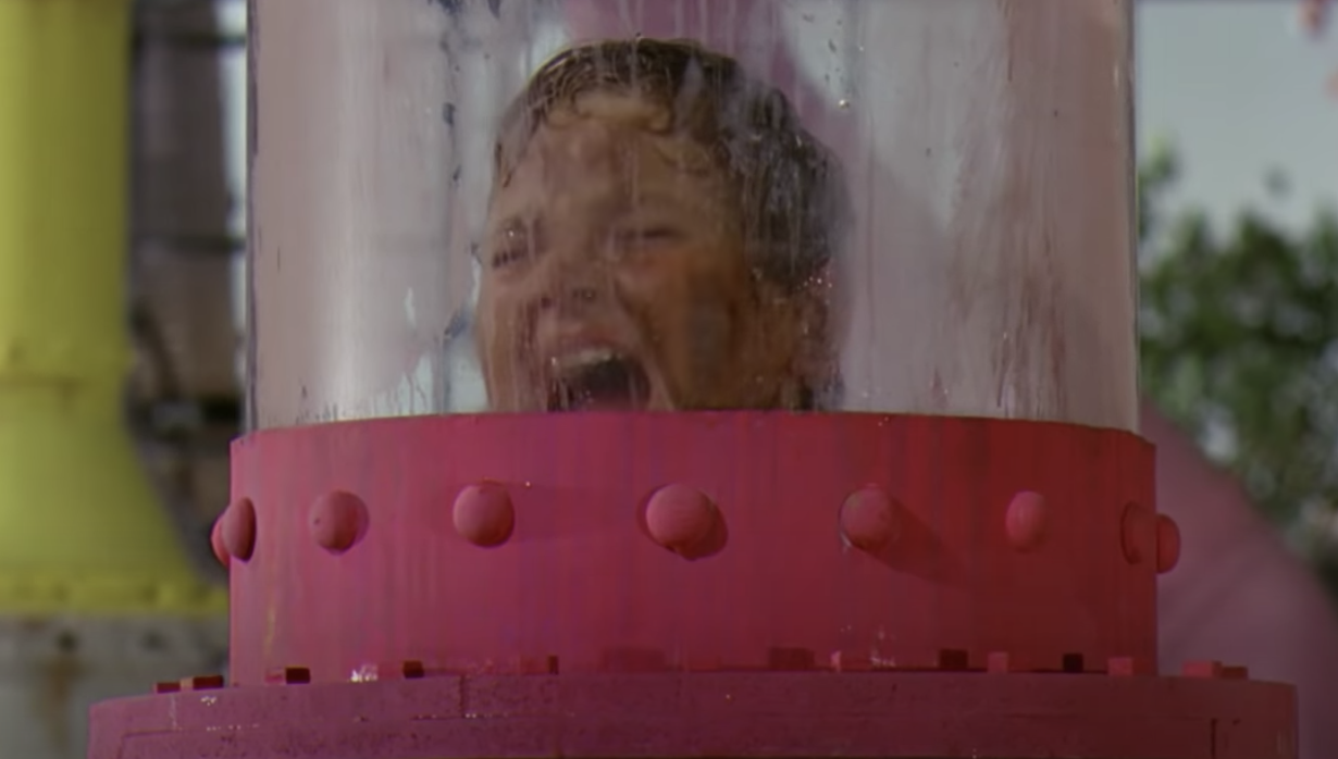 Augustus in the tube from the chocolate river