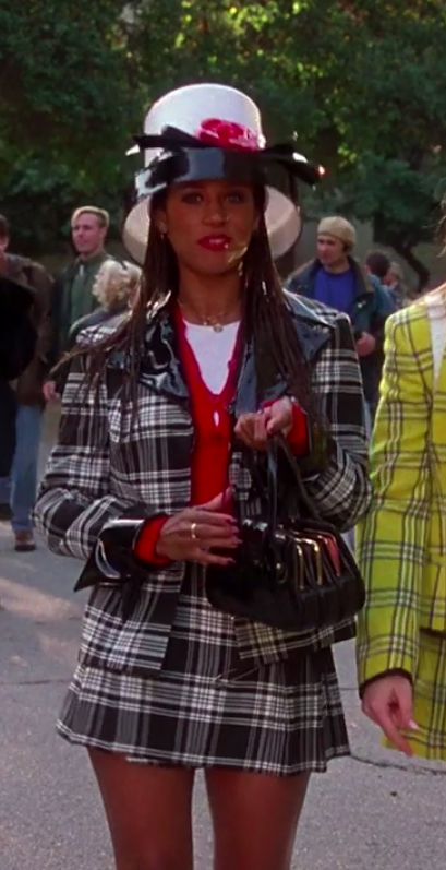 Dionne wearing a matching plaid outfit and a very large hat