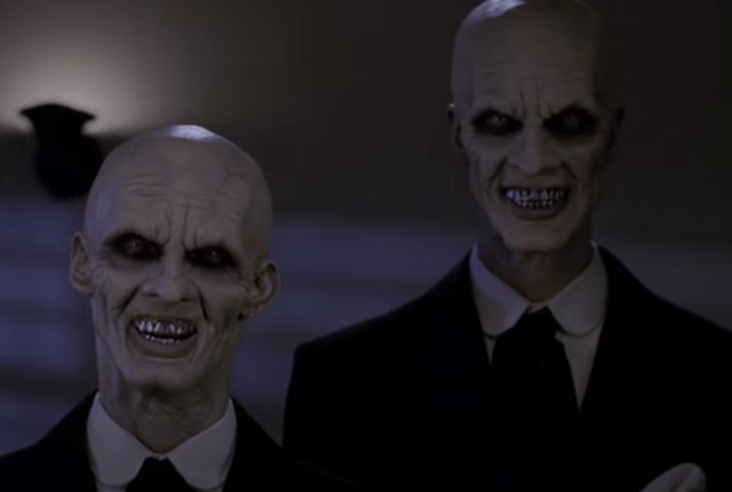 Two of the Gentlemen standing