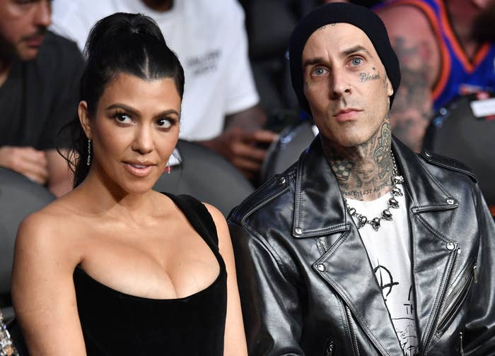 Kourtney and Travis sit next to each other while attending a boxing match
