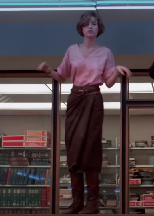 Claire wearing boots, a shin-length skirt, a pent, and a shirt