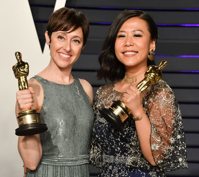 Domee posing with her Oscar backstage with a fellow Oscar winner
